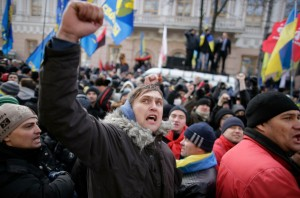 Protestors wave flags and shout slogans outside parliament in Kiev