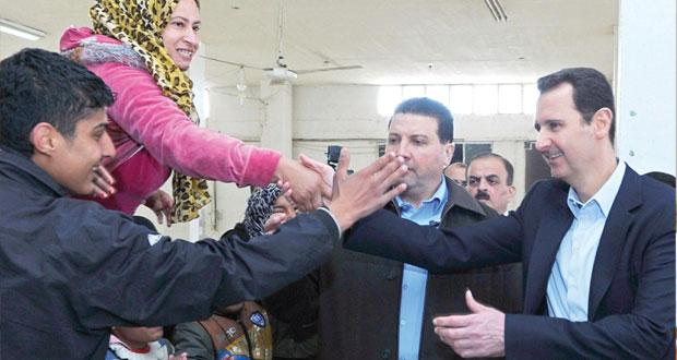 سوريا تفرض (التأشيرات) على العرب والأجانب والأسد يتفقد مركزا للمهجرين بعدرا