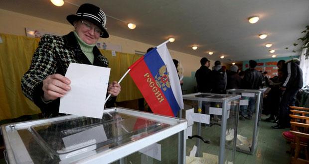 أوكرانيا : القرم تصوت بكثافة وبوتين يؤكد أنه سيحترم خيارهم