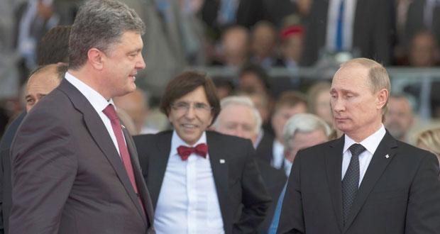 بوتين وبورشنكو يدعوان لإنهاء النزاع في أوكرانيا