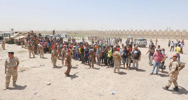 العراق يشن هجمات مضادة على (داعش) وآلاف يلبون دعوات حمل السلاح