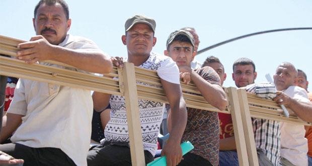 القوات العراقية تقاوم تقدم المسلحين ومطالبة عربية بوفاق وطني