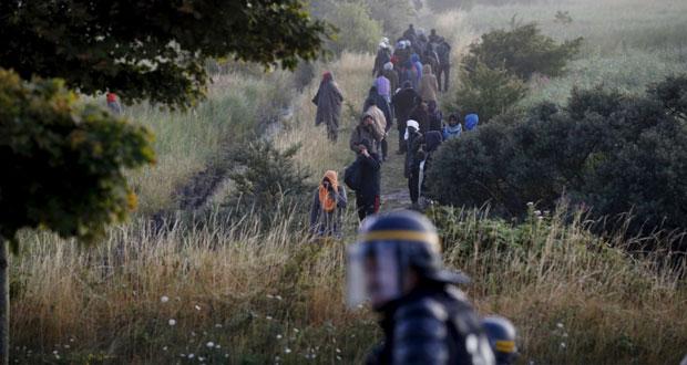 فرنسا وبريطانيا تتحدان على إنهاء أزمة المهاجرين وتطالبان بتدخل أوروبي شامل