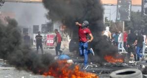 شهيد في غزة ومواجهات بالضفة والفلسطينيون يطالبون بنظام حماية دولي