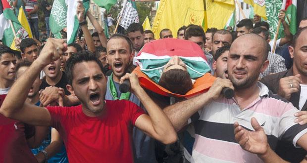 شهيدان أحدهما طفل ومئات الجرحى برصاص إسرائيلي في الضفة