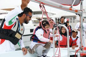 عُمان للإبحار والعمانية للنقل البحري يرسمان الابتسامة في وجوه الأطفال من الجمعية العمانية لمتلازمة داون