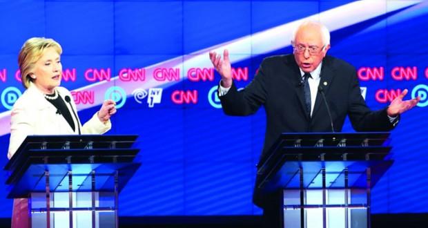 كلينتون وساندرز يتبادلان الاتهامات في مناظرة حامية