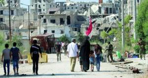 سوريا: خروج عشرات المدنيين من أحياء حلب ومسلحون يسلمون أنفسهم وأسلحتهم للجيش