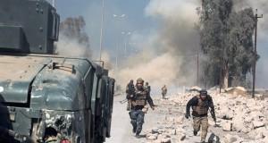 العراق: القوات داخل مطار الموصل وجهود لكشف الألغام والنواسف
