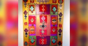الجزائرية دلال حلو تعرض التراث بالألوان