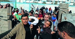 شهيد في غزة وآليات الاحتلال تهدم منشآت بالقدس