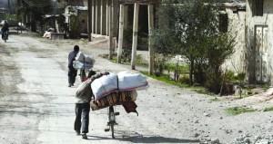 الإرهابيون يمنعون المدنيين من الممر الآمن بالغوطة