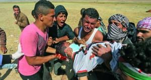 الاحتلال يواصل إرهابه ويصيب 100 فلسطيني في اليوم الثاني لهبة (يوم الأرض)