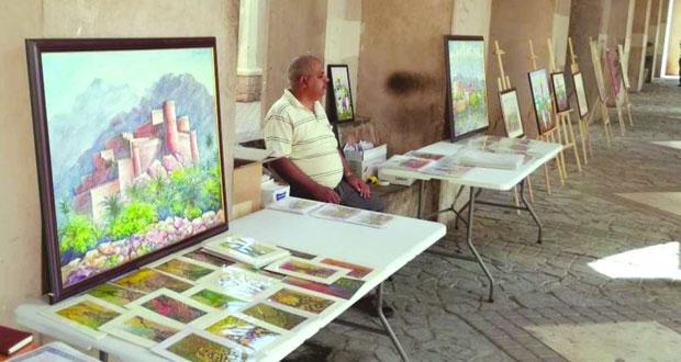 أمسية ومعرض فني في الخط العربي والفنون التشكيلية بنـزوى