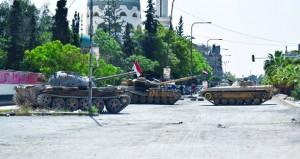 سوريا: قوى الأمن تدخل (الحولة) وترفع العلم السوري