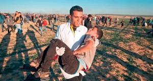 شهيد بالضفة وعشرات الجرحى في غزة