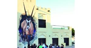 """تدشين جدارية"""" المها تمضي قدما"""" في الحي الثقافي بالدوحة"""